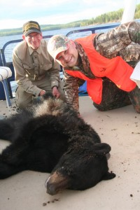 Hunters with their catch of a black bear