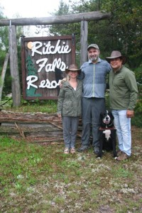 Lawrence, Kyla and Matthew, standing in front of the Ritchie Falls Resort sign