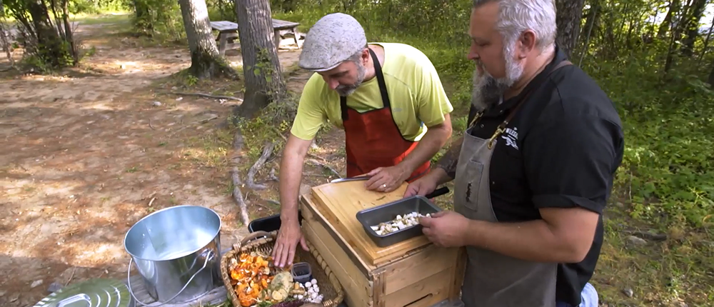 Lawrence Gunther and Steve Mitton preparing wild forage for their shore-side feast